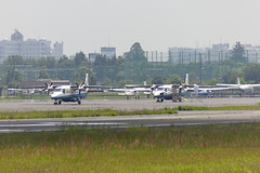A SMALL AIRPORT, SOME PARS AND CLOUDS - CLVII (Jussi Salmiakkinen (JUNJI SUDA)) Tags: chofu tokyo japan cityscape park airport sky aircraft wood airplane landscape tama 調布 飛行場 空港 林 森 空 武蔵野 多摩 東京 日本 風景 may clouds spring 2017 toukokuu apron