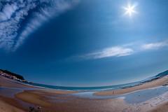 Sand And Sun (Derwisz) Tags: scarborough beach sea seaside seascape shore coast sky sun sunlight blue fisheye fisheyelens yorkshire englandseastcoast england unitedkingdom uk landscape light canon canoneos40d