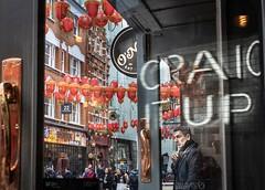 Craic it up (Wendy G Davies) Tags: street uk busy colour sign neon window smoke vaping smoking man bar pub chinatown london