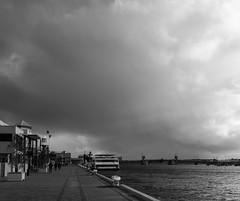 The Dolphin Explorer docked during the wild weather. (|Sarah|) Tags: blackwhite contrast portadelaide dolphinexplorer cloudy bnw winter highcontrast moody shadows blackandwhite silouhette clouds