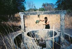 Gaspard au puit (louis de champs) Tags: filmphotography olympusxa2 kodakektar100 documentary senegal sinesaloum