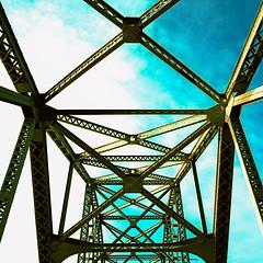 truss (xpro). sacramento, ca. 2010. (eyetwist) Tags: eyetwistkevinballuff eyetwist sacramento jibboom bridge xpro mamiya 6mf 50mm kodak ektachrome e100vs crossprocessed crossprocess mamiya6mf mamiya50mmf4l kodakektachromee100vs crossprocessede6toc41 ishootfilm analog analogue film emulsion mamiya6 square 6x6 mediumformat 120 primes filmexif ai epsonv750pro filmtagger americanriver sacramentoriver infrastructure jibboombridge girder truss steel girders roadway sky green norcal california river geometric pattern geometry bridgework cyan teal northern 6 cross process processed jibboomstreet angles symmetry