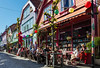 Alfresco in Stavanger (clive_metcalfe) Tags: stavager norway alfresco buildings cobbles cobblestones sitting lanterns street tree activity table chair flag norwegian