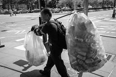 Recycling (ep_jhu) Tags: nyc x100f newyork bags recycling ny pole fujifilm brooklyn man cans sidewalk newyorkcity fuji latas acros bw carrying unitedstates us