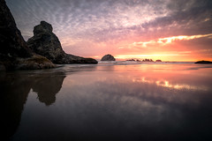 Reflections (Manuela Durson) Tags: reflections ocean bandon oregon oregoncoast sunset sunsetoverwater sunsetoverocean face rock facerock coast coastal dramatic clouds cloudscape oceanscape seascape nobody