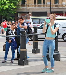 Colour Cordinated (Waterford_Man) Tags: girl jeans blue tourists london candid glasses people path mobile phone