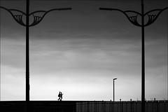 F_47A2647-2-BW-Canon 5DIII-Tamron 28-300mm-May Lee 廖藹淳 (May-margy) Tags: maymargy bw 黑白 人像 街燈 堤防 圍籬 雲彩 逆光 剪影 幾何構圖 點人 點物 臉譜 portrait backlighting silhouette streetlamps fence facesinplaces humaningeometry clouds 街拍 streetviewphotography 天馬行空鏡頭的異想世界 mylensandmyimagination 線條造型與光影 linesformandlightandshadow 心象意象與影像 naturalcoincidencethrumylens 新竹市 台灣 中華民國 hsinchucity taiwan repofchina f47a26472bw embankment seashore 海邊 canon5diii tamron28300mm maylee廖藹淳