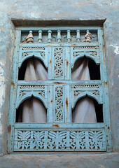 Wooden carved window of an abandoned house, Dhofar Governorate, Mirbat, Oman (Eric Lafforgue) Tags: abandoned arabia arabianpeninsula arabic arabicarchitecture arabicstyle architecture blue buildingexterior carved carvedwindow carvingcraftproduct colorimage day decrepit dhofar dhufar exteriorview facade ghosttown gulfcountries habitation history house houseexterior mirbat moscha nopeople old oldhouse oman oman18192 outdoors sultanate thepast traveldestination traveldestinations vertical weathered window woodenwindow dhofargovernorate om