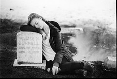 Emulating Robert Capa (theelectricmango) Tags: nikonf3 film filmsnotdead filmisalive model portrait robert capa grain black and white grave cemetery gates the smiths edgy university photography student project bokeh water 85mm vintage