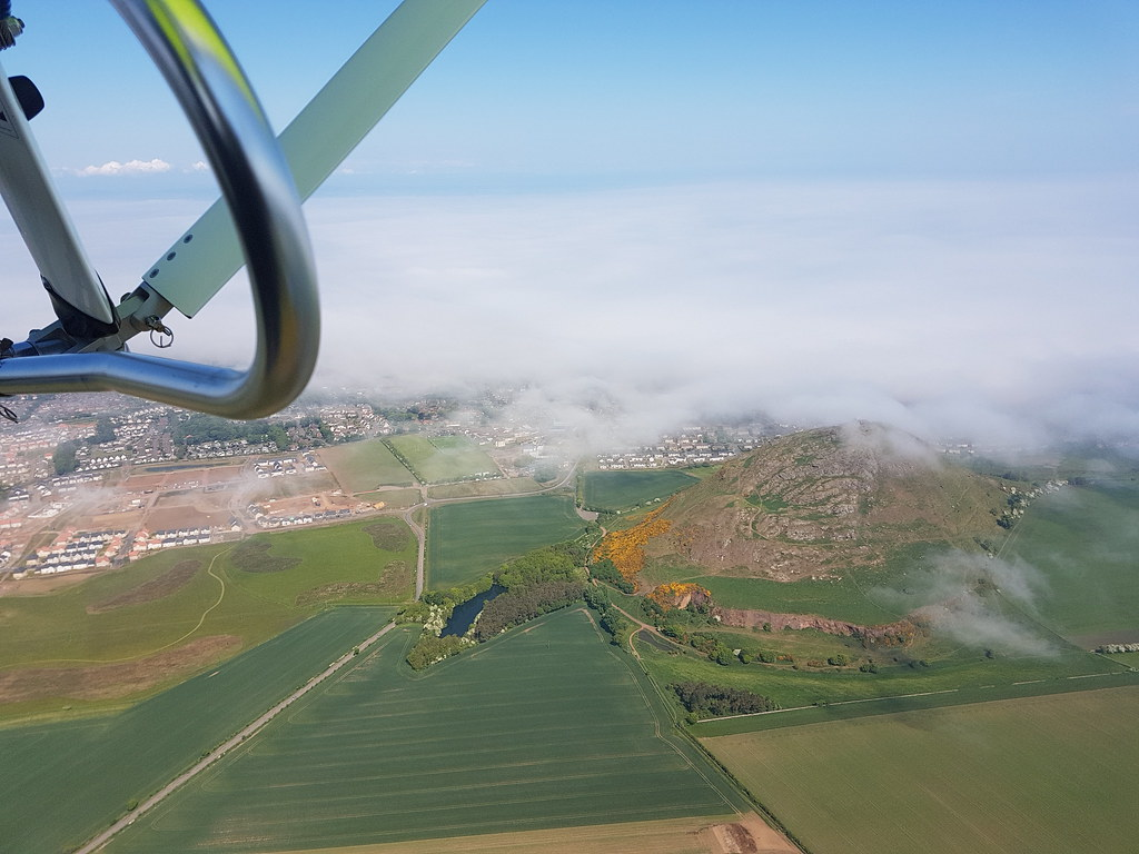 11:50am - half an hour after clearing the airfield the fog has just cleared Berwick Law and is in the process of clearing North Berwick.