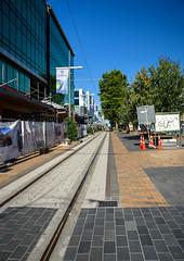 New Buildings (Jocey K) Tags: newzealand nikond750 christchurch building architecture rebuild mall roadcones flags trees shadows sky cbd