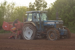 Ford 8210 Tractor with a Grimmer VL20B 4 Row Potato Planter (Shane Casey CK25) Tags: ford 8210 tractor grimmer vl20b 4 row potato planter new holland casenewholland newholland blue castletownroche traktor trekker traktori tracteur trator ciągnik sow sowing set setting drill drilling tillage till tilling plant planting crop crops cereal cereals county cork ireland irish farm farmer farming agri agriculture contractor field ground soil dirt earth dust work working horse power horsepower hp pull pulling machine machinery grow growing nikon d7200