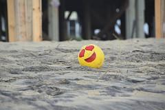 I'm Happy (meg21210) Tags: nc obx outerbanks northcarolina pier beach ball beachball yellow redhearts abandoned lost sand