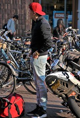 IMG_9357 (Skinny Guy Lover) Tags: outdoor candid guy man male dude jeans bluejeans cap winterjacket bag backpack smoking smoker sideprofile sneakers motorcycle bike scooter