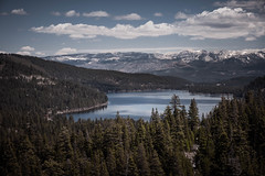 A view of the Donner Lake, California, with lots of trees and snow on the mountains on the background. (pedferr) Tags: horizon sunny landscape winter nature woods usa unitedstatesofamerica trip lake hill sky clouds bluesky morning scene summit summer snow travel forest hiking park outdoors green california lifestyle cold mountain