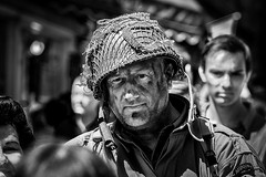 Face in the 1940s weekend crowd (jackharrybill) Tags: haworth 1940s monochrome black white portrait streetphotography military army airborne helmet sharp crisp outdoors light