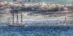 Storm's coming (Gunn Shots.) Tags: auckland haurakigulf tīkapamoana newzealand gatheringstorm stormy clouds waves schooner tallship sailboats skytower