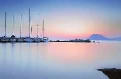 Relaxing... (Bo.Th) Tags: colors calm coast rocks dock rock beach sky seaside sea silence seascape sun stone structure sunset water weather waterfront view mountain marina moody romantic dreaming relax reflection blue boat bay light greece