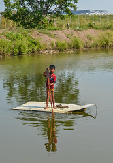 A boy rowing boat on river (phuong.sg@gmail.com) Tags: asia asian bangkok blue boat building bungalow cambodia cambodian culture east fisherman fishing float home house lake landscape life national nature nautical outdoors people pier poor poverty reflection river roof rural ship sky thailand tradition traditional transport travel tropic tropical vacation village water wood wooden