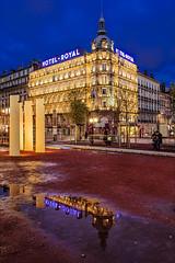L'autre côté (Michael Muraz) Tags: europe france lyon rhônealpes world blue bluehour building city cityscape dusk hotel night nightphotography nightscape puddle reflection town twilight water rhonealpes