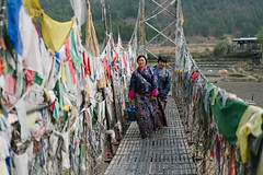 ATA01155 (A. adnan) Tags: bhutan travel women traditional dress paro sony bridge morning walking