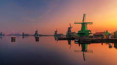 Windmills and a burning Sky (oliver.herbold) Tags: zaanseschans holland netherlands zaanse zaandijk mills windmills reflection morning sunrise water travel light colors colours glow burningsky orange longexposure landscape fairytale farm oliverherbold