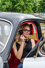 Pin-up style girl at autoshow (yedmitry) Tags: purple pinup model ukrainian beauty car motorshoe motorshow