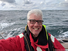 Afternoon Happiness (David J. Greer) Tags: north atlantic ocean winter crossing passage storm sailboat rubicon3 sailtrainexplore oriole bowman spain arrival six days sailing coat life jacket smile smiling cockpit outside grey hair glasses horizon skies cloudy wake finish complete