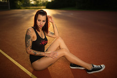 sports field in the evening (Michael Kremsler) Tags: model girl redhair longlegs body sneakers portrait fashion streetfashion sporty tattoo sundown bokeh evening summer strobist shooting sportsfield