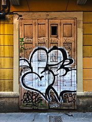 Old Painted Door (pàmies photo) Tags: door old wood love hdr urban citiy town street streetart graffiti artisticphotography artisticphoto photography photo artwork travel travelling gracia barridegracia barcelona catalonia catalunya freepoliticalprisoners