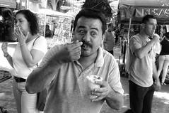 A happy customer with fellow street epicureans (posterboy2007) Tags: tlaquepacque guadalajara mexico corn vendor street food mayonnaise customer cholesterol epicurean
