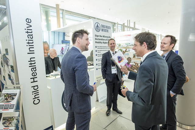 Floor Lieshout talks with visitors in front of the Child Health Initiative exhibition stand