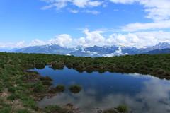 gouille à vaches (bulbocode909) Tags: valais suisse mex gouilles étangs prairies montagnes nature paysages printemps nuages vert bleu reflets eau groupenuagesetciel