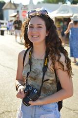 Nikon at the ready (radargeek) Tags: paseoartsfestival paseodistrict okc oklahomacity 2018 may festival sunglasses nikon photographer smile