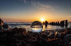sunrise in Glass (drummerwinger) Tags: rot sunrise sonnenaufgang beach strand wolken himmel clouds wasser water canon80d tokina glaskugel sun ostsee rügen dranske glowe