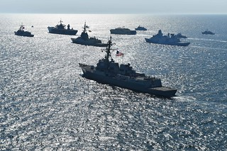 Thirty maritime unit ships from 12 nations maneuver in close formation for a photo exercise