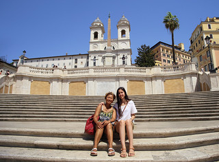 Sitting on the Spanish Steps, one of the symbols of Italy