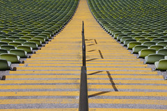 Stadium Symmetry (CoolMcFlash) Tags: arena stadion stadium munich germany olympiastadion symmetry symmetrie symmetrisch abstract abstrakt canon eos 60d stairs empty münchen deutschland stufen treppen leer fotografie photography tamron b008 18270 lines linien yellow green grün gelb