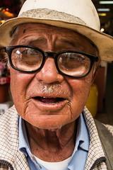 Street Portrait (klauslang99) Tags: streetphotography portrait klauslang face glasses hat person