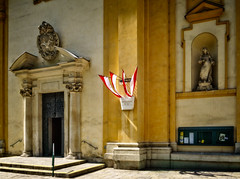 Religion and state (Tigra K) Tags: wien austria at 2017 architdetail architecture baroque church city column door flag light portal repetition sculpture statue vienna arch art