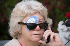 Pirate on the Phone (LongInt57) Tags: woman women person people eyepatch eye patch sunglasses telephone phone talking surgery outdoors kelowna bc canada okanagan