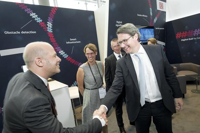 Deutsche Bahn representative greets Andreas Scheuer at the Deutsche Bahn stand
