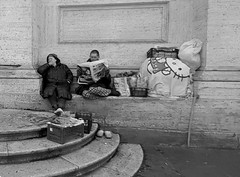 Reading the newspaper, (Homeless couple in Rome) (Armando Moreschi) Tags: homeless couple rome homelesscouple roma bn bw poveri poor giornale newspaper