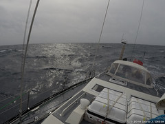 Heeled Over on the Atlantic (David J. Greer) Tags: north atlantic ocean winter crossing passage storm sailboat rubicon3 sailtrainexplore oriole bowman deck heeled grey sea sky clouds cloudy life raft dodger