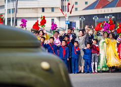 Waving at the soldiers, Pyongyang (TeunJanssen) Tags: parade waving dprk northkorea korea dof 75mm 75mmf18 olympus omd omdem10 people backpacking worldtravel worldtrip ypt youngpioneertours
