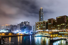 Illuminated Office Blocks And Apartments Overlooking Kowloon Harbour, Hong Kong (Peter Greenway) Tags: hongkong harbour hk flickr nightphotography offices nighttime skyscrapers nightlights urban officeblocks water illuminated kowloon skyline reflection night