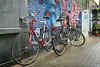 Amsterdamp bikes (jimj0will) Tags: amsterdam amsterdamp bikes street graffiti paint wet damp blue red