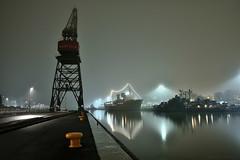 Harbour Lights V (Kojaniemi) Tags: mist fog crane kimmoojaniemi kojaniemi nightphotography trawler minesweeper water reflection harbor harbour port dock wharf mooringpost bitt forummarinum