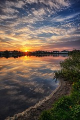 Summer evening, Nprway (Vest der ute) Tags: xt2 norway rogaland haugesund water waterscape landscape lake sky clouds grass trees flowers reflections mirror houses fav200