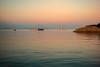 Sunset anchorage.... (Dafydd Penguin) Tags: sun set sunset sea water sky boats sailboat yacht yachting coast coastal moorings harbour bay harbor port porto azzurro elba island tuscany italy leica m10 7artisans 50mm f11